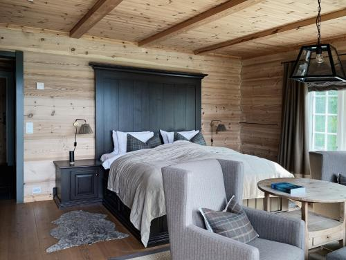A bed or beds in a room at Storfjord Hotel