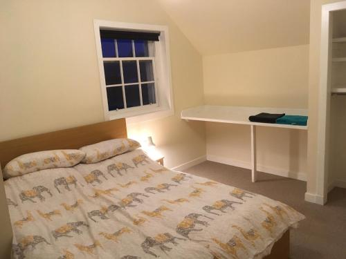 A bed or beds in a room at St Olaf's Wynd (the ancient heart of Kirkwall)