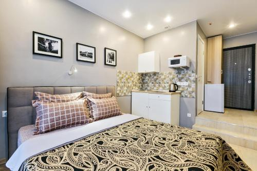 A bed or beds in a room at Apartments Vnukovo Moscow
