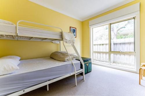 A bunk bed or bunk beds in a room at WALKIN' ON SUNSHINE
