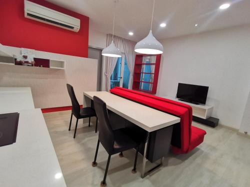A television and/or entertainment centre at Strait Garden Studio X Ace Pro @ George Town