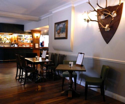 A restaurant or other place to eat at Tulloch Castle Hotel 'A Bespoke Hotel'