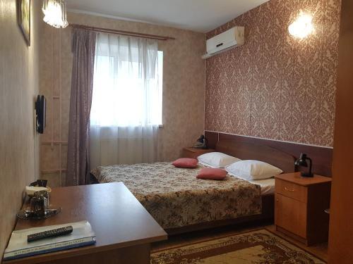 Кровать или кровати в номере Lucky Stars Hotel