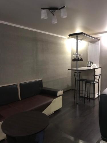A seating area at Apartments Gagarina 72