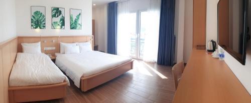 Ein Bett oder Betten in einem Zimmer der Unterkunft MIA Hotel