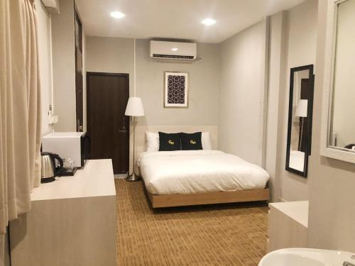 A bed or beds in a room at GN Luxury Hostel