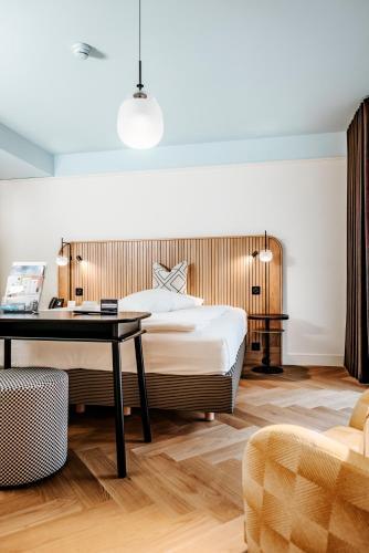 Ein Bett oder Betten in einem Zimmer der Unterkunft Best Western Plus Hotel Bern