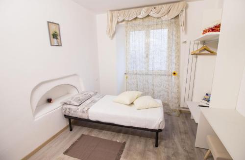 Letto o letti in una camera di Loft Maison 1706 Lago Orta
