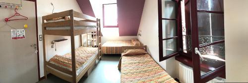 A bunk bed or bunk beds in a room at La Brise de Mer