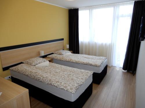 A bed or beds in a room at Rómahegy Rendezvényház