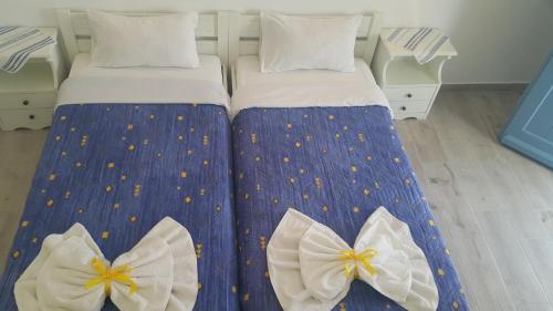 Ein Bett oder Betten in einem Zimmer der Unterkunft Augusta Studios & Apartments