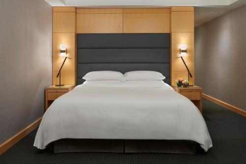 A bed or beds in a room at The SoHo Hotel