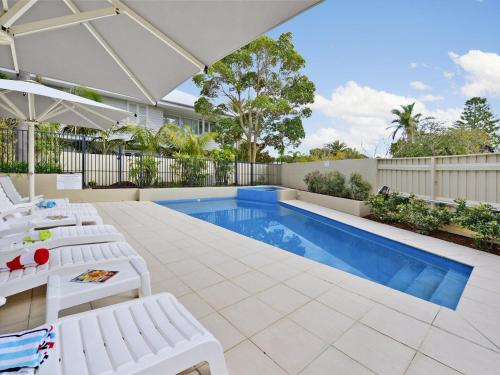 The swimming pool at or near The Lookout at Iluka Resort Apartments