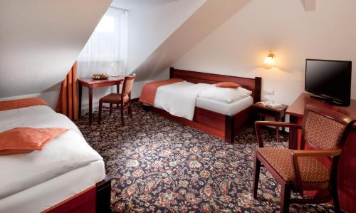 A bed or beds in a room at Chateau Monty Spa Resort