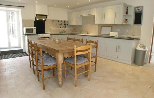 A kitchen or kitchenette at Holiday Home La Blotiere