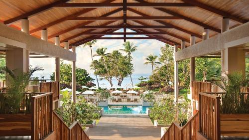 The swimming pool at or near Kempinski Seychelles Resort