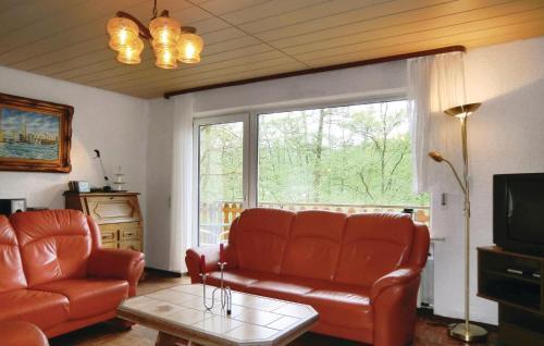 Ein Sitzbereich in der Unterkunft Holiday Home Lutzkampen V