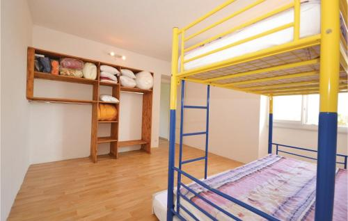 A bunk bed or bunk beds in a room at Three-Bedroom Holiday Home in Bagard
