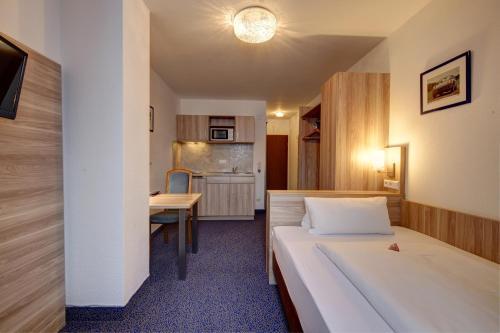 Ein Sitzbereich in der Unterkunft Hotel Deutschmeister