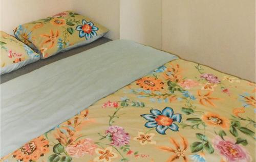 A bed or beds in a room at Two-Bedroom Holiday Home in Woerdense Verlaat