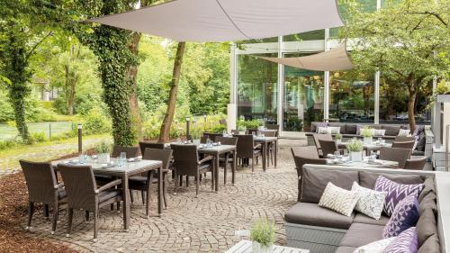A restaurant or other place to eat at Hilton Munich Park