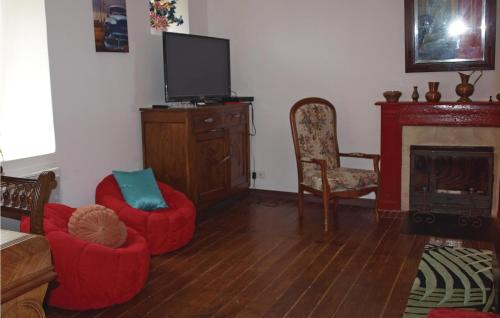A television and/or entertainment center at Awesome home in Treguier with WiFi and 5 Bedrooms