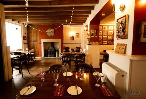 A restaurant or other place to eat at Forresters Hotel, Bar & French Restaurant