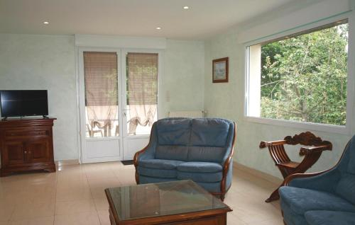 A seating area at Holiday Home Pledran with Fireplace I