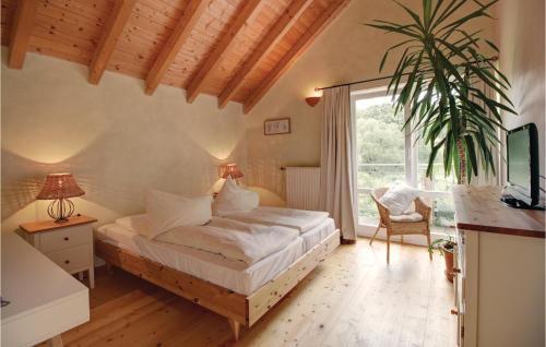 Ein Bett oder Betten in einem Zimmer der Unterkunft Four-Bedroom Holiday Home in Uslar