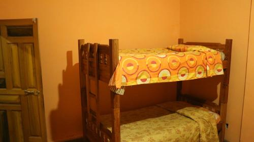 A bunk bed or bunk beds in a room at Hostal Graciela