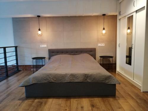 Postel nebo postele na pokoji v ubytování RedCity LOFT