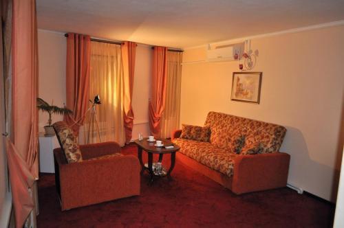 A seating area at Family hotel on the lake Lakada