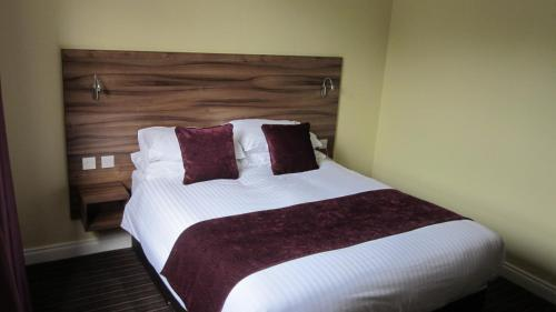 A bed or beds in a room at Mourne Country Hotel