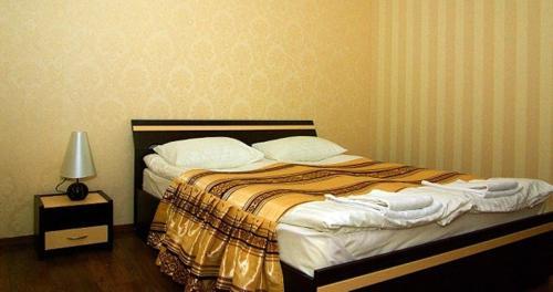 Кровать или кровати в номере Hotel Deluxe