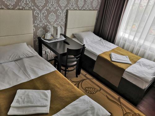 Кровать или кровати в номере Гостиница Магадан