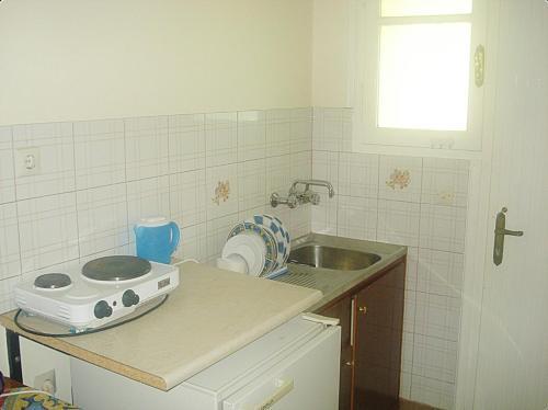 Кухня или кухненски бокс в Villa Theodora