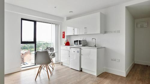 A kitchen or kitchenette at Comfortable studio in Oldham, minutes to Royal Oldham Hospital