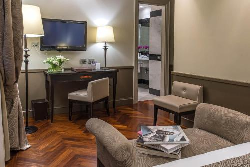 A television and/or entertainment center at Hotel Lunetta