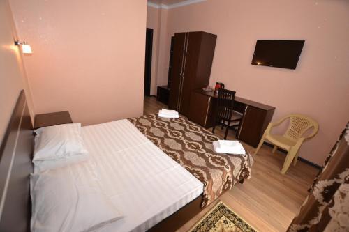 Кровать или кровати в номере Guest House Azov