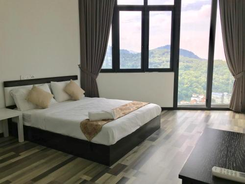 A bed or beds in a room at Cozy 3BR Family Suites with Amazing View @ Level39
