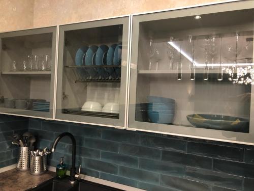 A kitchen or kitchenette at Апартаменты в ЖК «Акватория»