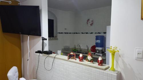A kitchen or kitchenette at APTO - PETRÓPOLIS - RIO