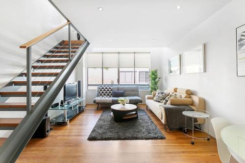 A seating area at The Precinct - A Bondi Beach Holiday Home