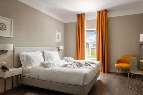 A bed or beds in a room at Hotel D. Luis - Elvas