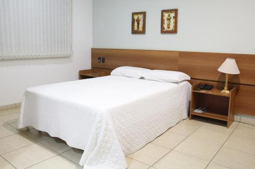 A bed or beds in a room at Buriti Hotel