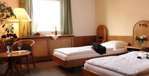 A bed or beds in a room at Landhotel Margaretenhof