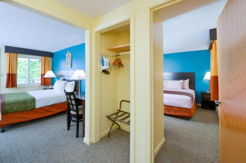 A bed or beds in a room at Rodeway Inn Orleans - Cape Cod