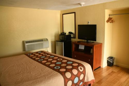 A television and/or entertainment center at Boston Motel