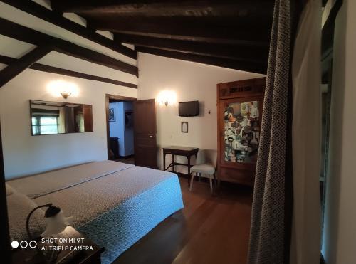 Cama o camas de una habitación en Hotel Rural Natxiondo