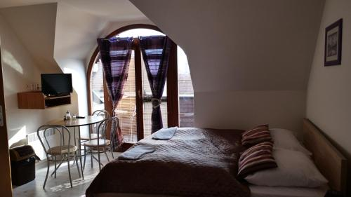 Posteľ alebo postele v izbe v ubytovaní Penzion Real